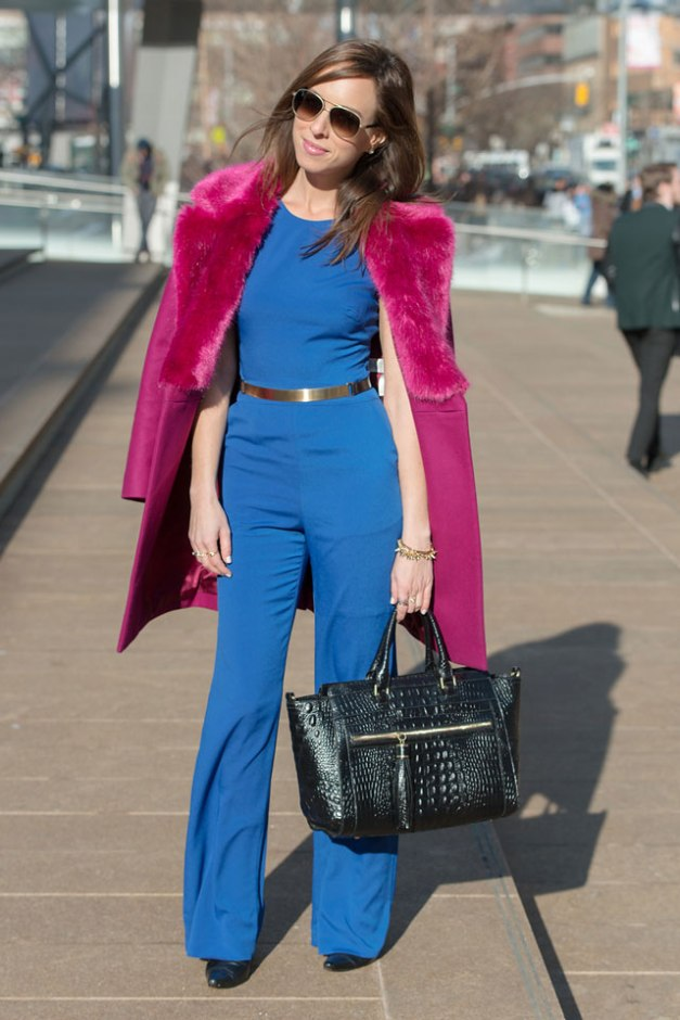 Sydne-Style-New-York-fashion-week-street-style-lincoln-center-blue-jumpsuit-bebe-american-hustle-70s-inspired-fashion-faux-fur-hot-pink-trend